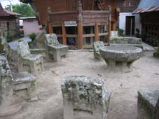 300 year old stone chairs at Lake Toba